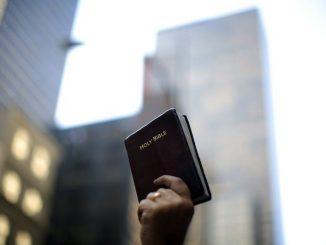 Bible held up